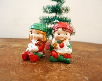 Vintage Avon 1983 Pair of Christmas  Boy and Girl Elf Pixie Salt and Pepper Shakers With Toys