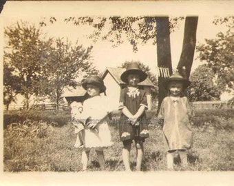 Vintage Photograph Three Darling Little Girls wearing Hats Dresses Holding Doll