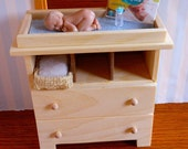 Changing Table, Baby, Basket of Pampers and Bottle