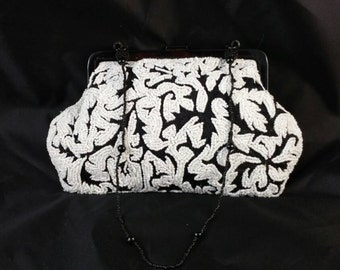 White Bead Bag with Black Fabric Background Signed Wayne M Klein