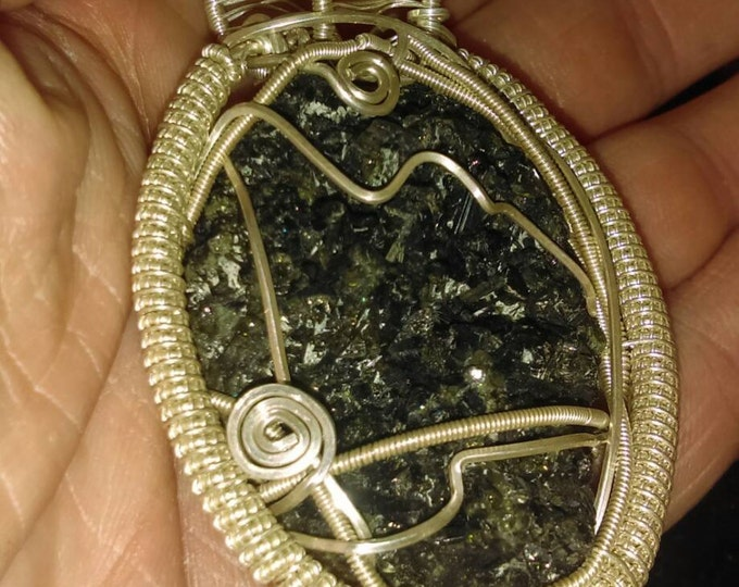 Featured listing image: Sterling silver wire wrapped, green tourmaline cluster.