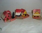 H) Three Small Cardboard Christmas Houses