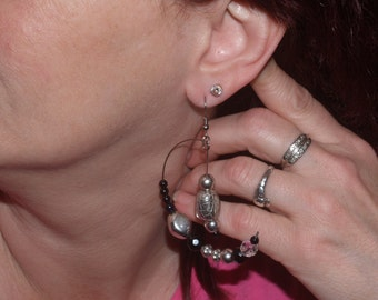 "Silver-tone 1 1/2"" long earrings w/ silver-tone and glass beads, and silver-tone beads suspended from center post."
