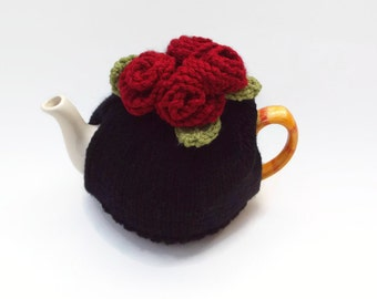 tea cozy hand knitted  cosie  black   base and  red knitted  roses