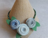 Green Beaded Necklace with Rosette Trio in Shades of Blue