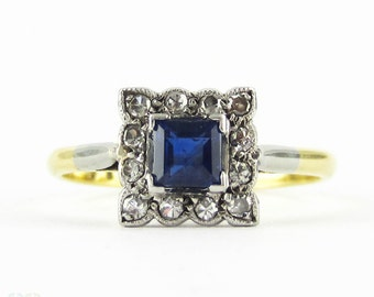 Art Deco Sapphire & Diamond Engagement Ring, Square Shape Blue Sapphire with Milgain Detail Diamond Halo. Circa 1920s, 18ct Platinum.