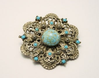 Vintage turquoise glass brooch.
