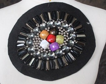 Very cute  embroidered   and  beaded    applique  black  color