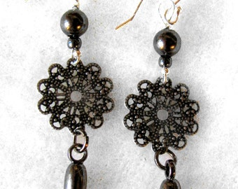 Black snowflake dagger earrings