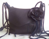 Black leather handbag with fringe by Tuscada. Reserved for 'S'