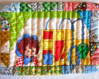 Reversable Raggedy Ann and Andy quilted mug rug