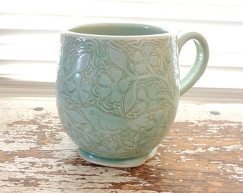 Handmade Cup in Stoneware with Pale Green Hand Carved Flowers and Birds
