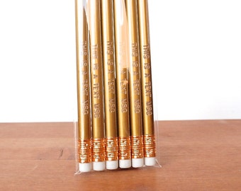 engraved pencils: gold pencils, this is a text message