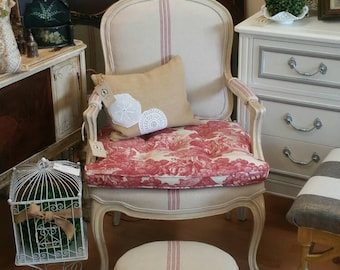 French grainsack armchair with coordinating ottomon in red and cream
