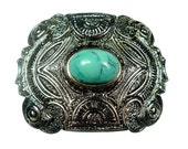Belt buckles, silver tone tone metal with turquoise colored cabochon