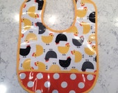 Colorful laminated baby bib with chickens!