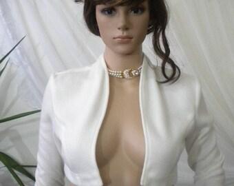 Elegant ladies white fluffy bolero made of fleece.
