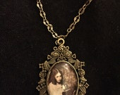 Lorina LIddell and Doll Cameo Necklace