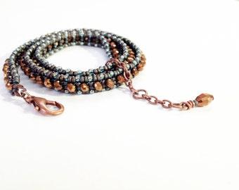 beaded wrap bracelet in bronze, aqua and matte iris blue