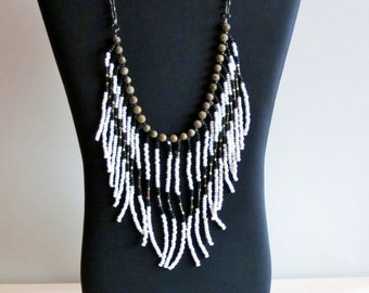 Native American beaded necklace in white, dark green and gold
