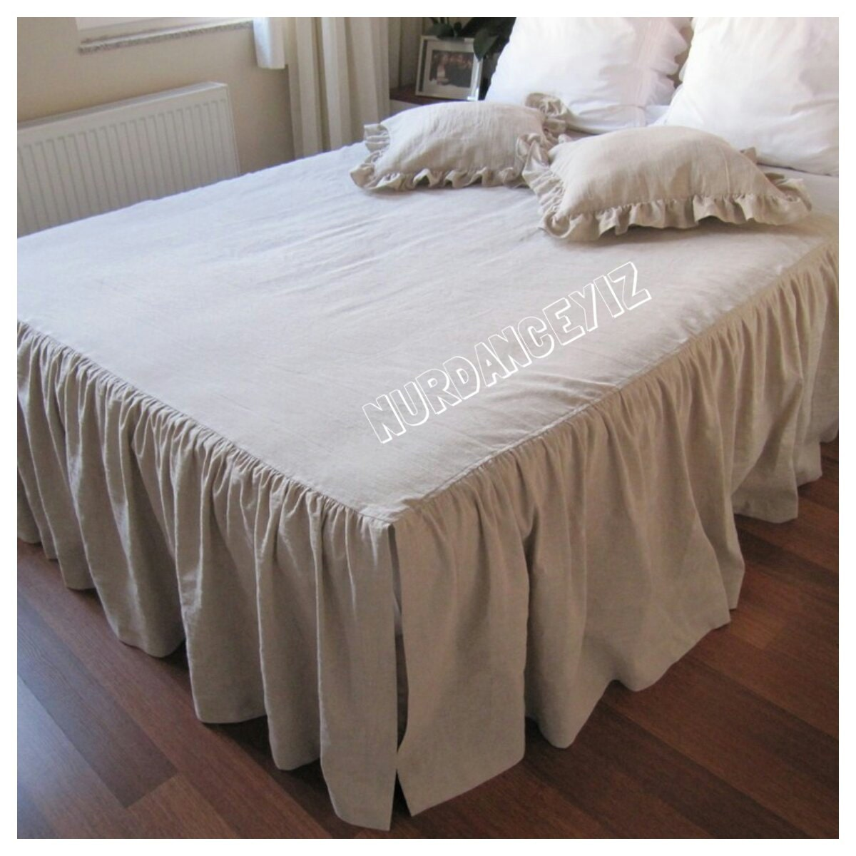 % linen bedskirt. % cotton deck. Detailed with pintuck pleats and ruffled hem with frayed edges. 17