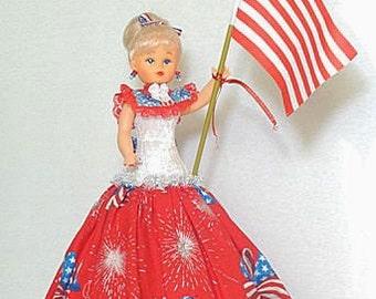 Regina, musical Caucasian doll, plays God Bless America as she turns
