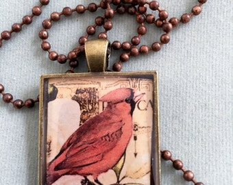 Cardinal Penindant with Antique Brass and Resin