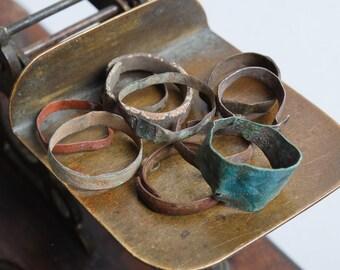 Set of 10 antique  brass rings, parts, connectors, black patina, primitive finding