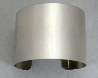 1 1/2 inches wide by six inches long, one dozen (12) Aluminum Cuff Bracelet Blanks