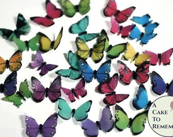 "48 small rainbow edible butterflies, additional colors available. 1/2"" - 3/4"" sized cake or cupcake topper, cake pops or smash cake topper."