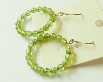 Peridot hooped gemstone earrings on gold plated sterling silver shepherds hooks