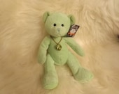 "August green stuffed bear with green Peridot stone pendant on chain and tag. ""Bears of the Month"", embroidered: AUGUST.Mint. Gift.  RUSS."