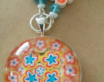 Sale was 18 now 16uk Orange Yellow and Blue Faux Milli Fiori Necklace .