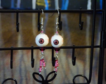 Pink and red eyeball earrings