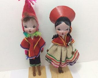 Costume dolls, boy and girl with baby, souvenirs, Peru Ecuador south America