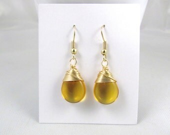Yellow earrings honey colored glass smooth teardrops wire wrapped earrings in gold craft wire