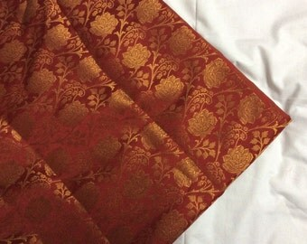 One yard of Indian silk brocade in red with  gold flowers and vines