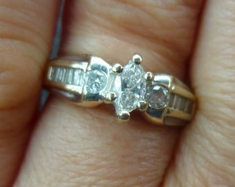 1970's  engagment ring.....50 points of  diamonds.....VERY BRIGHT Daimond....in 14KT white gold