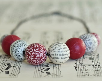 Red chunky fabric and book page covered bead necklace