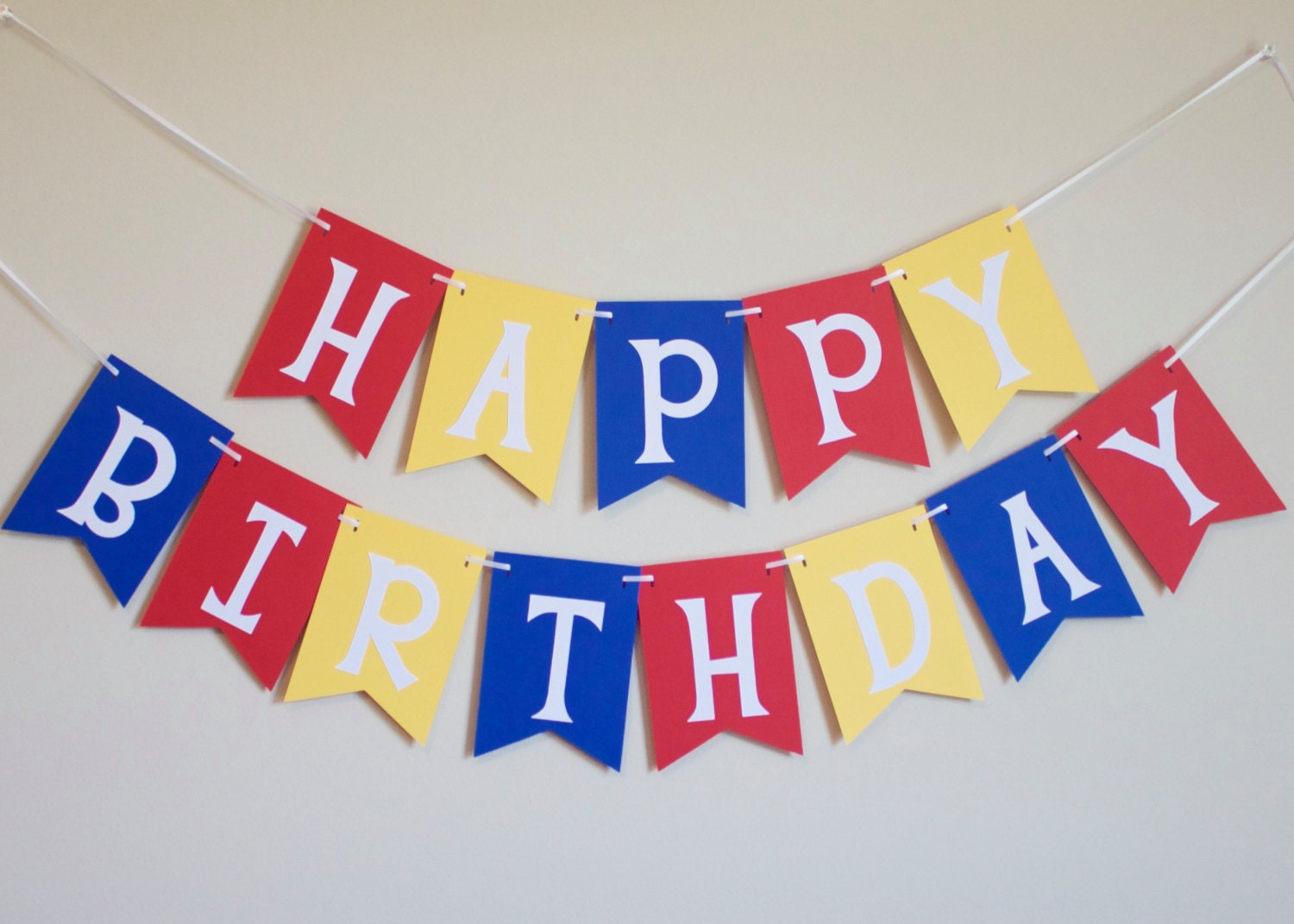 happy birthday banner in red yellow and blue by