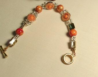 marbled orange bracelet and earrings