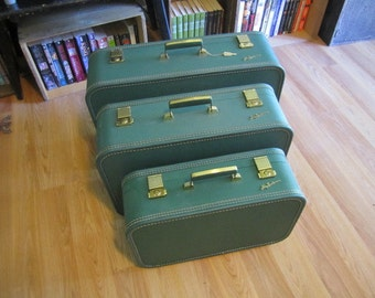 Set of Three Lady Baltimore Suitcases with Key Green Suitcases. Set of Suitcases. Hard shell Lady Baltimore Luggage