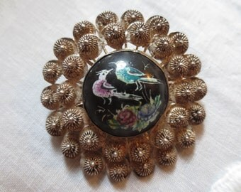 Exquisitely hand painted Enamel Center dome of Birds & Flowers, surrounded by Silver Filigree