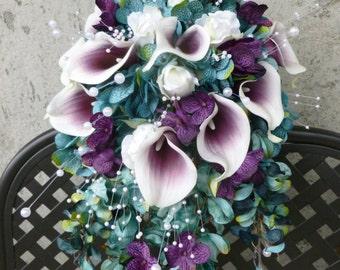 Teal plum cascading bouquet with picasso calla lilies, blue, purple hydrangea bouquet, teardrop bouquet, peacok feathers, pearls
