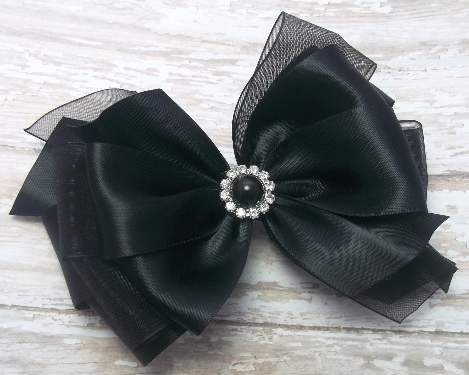 The black satin silk bow tie is the most popular black bow tie out there simply because most tuxedo lapels are faced with satin. Traditionally, the material of the bow tie should match the tuxedo lapels it is paired with, and so satin is the number one choice.