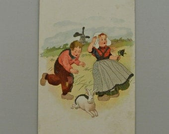 "Small Dutch Easter Postcard with Glitter 1898 4 3/4"" x 3""."