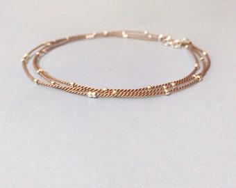 tiny silver beaded dainty triple wrap silk cord layering bracelet.