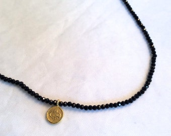 tiny Black spinel bead necklace with  vermeil disc