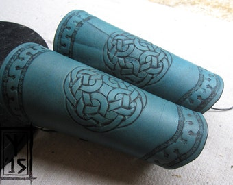 Custom leather bracers with Celtic knot and meander