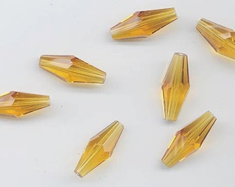 Twelve vintage Swarovski crystal beads - Art. 5205 - 17.5 x 7 mm - topaz